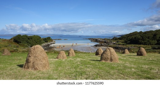 Traditional haystacks at Back of Keppoch  in Arisaig with a view towards Skye in the Scottish Highlands.