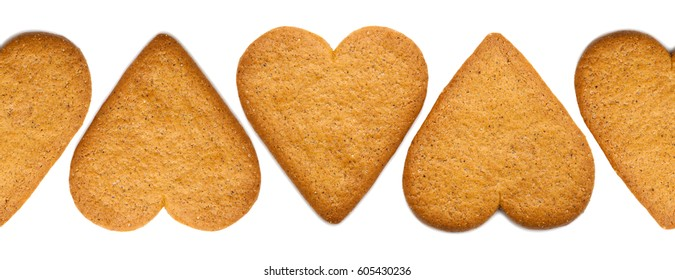 traditional heart shaped thin ginger biscuits border isolated on white background