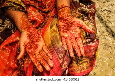Traditional henna on brides hands on wedding in Bangladesh