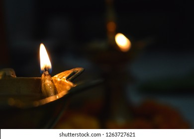 a traditional hindu way of prayer called deepam. it is lit by a thread dipped in oil