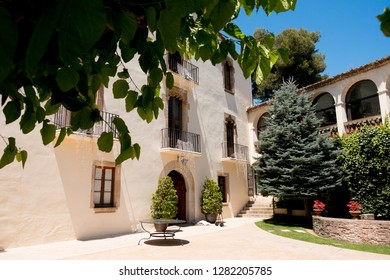 traditional historic catalan house called masia in spanish countryside, perfect location for summer holidays