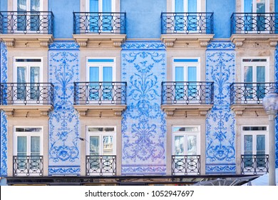 Traditional historic facade in Porto decorated with blue tiles, Portugal