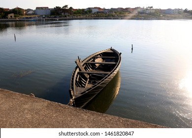 Traditional historic wooden boat called Condura Croatica, in port of Nin, Croatia.