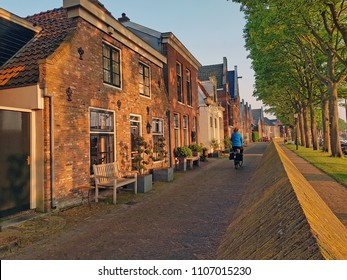 Traditional historical dutch houses at the waterfront in the city Muiden in the Netherlands