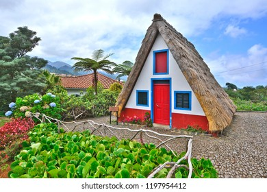 Traditional home constructed with sloping triangular rooftops, and protected with straw, Santana, Madeira Island, Portugal
