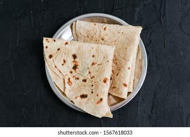 Traditional home made Caribbean Sada Roti, Paratha Roti, Fulka Indian bread Mumbai India. Folded flatbread whole wheat Chapathi, Chapatti, Chappathi.