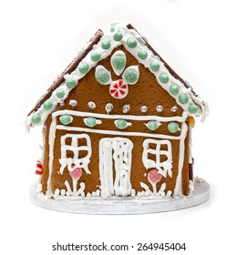 Traditional home made Ginger bread house isolated on a white studio background.