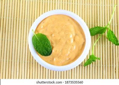 traditional home made ranch dressing with mint herb isolated in bowl