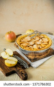 Traditional home-made autumn Apple pie-Charlotte, on a light background with appliances.