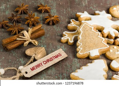Traditional homemade Christmas biscuits,  star anise and cinnamon on rustic background.