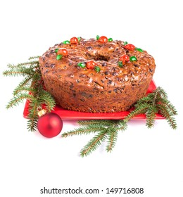traditional homemade christmas fruitcake decorated with candied cherries boughs and baubles - Christmas Fruit Cake Decoration