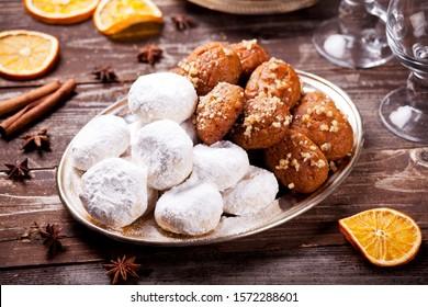 Traditional homemade greek melomakarona and kourabiedes for Christmas