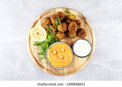 Traditional homemade hummus, falafel and chickpea served with spices on table. Jewish Cuisine with falafel
