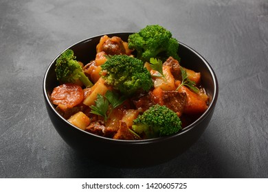Traditional homemade Hungarian beef meat stew, Goulash with potatoes, carrots , tomatoes, broccoli in a bowl