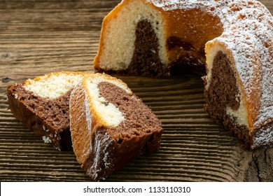 Traditional homemade marble cake. Sliced marble bundt cake on wooden table