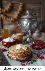 Traditional homemade slapjacks with butter, honey, milk and cottage cheese on vintage wooden table background
