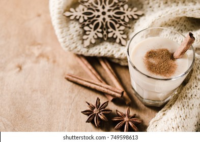 Traditional Homemade Winter Eggnog Cocktail with Whipped Cream and Cinnamon for Christmas Eve and Winter Holidays. Selective Focus. Copy Space