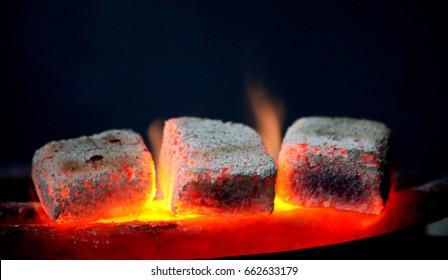 traditional hookah hot coals for smoking natural lighting close up