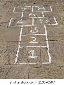 A Traditional HopScotch Game Marked Out on Slabs.