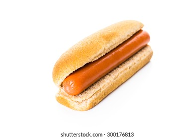 Traditional hot dogs on a white hot dog bun on a white background.