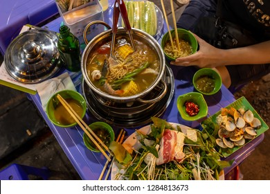 traditional hot pot at a street kitchen in Hanoi