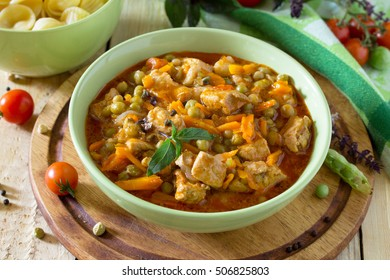 Traditional hot ragout with meat and vegetables stewed in tomato sauce for a healthy diet.
