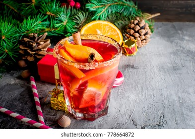 Traditional hot toddy winter drink with spices recipe. Healthy organic homemade holiday celebration beverage in glass.