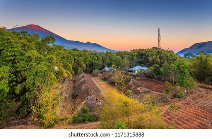 Traditional house of Bayan Sembalun Lombok with mount Rinjani as a background