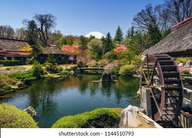 Traditional house with beautiful spring garden and mount Fuji view from Oshino Hakkai village, Yamanashi, Japan. Architecture landscape for travel destination.