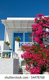Traditional house with Bougainvillea in Santorini, Greece