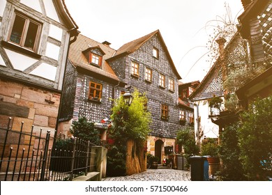Traditional house in the German style in Bavaria. The architecture of houses in Germany.
