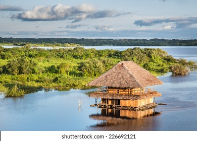 Traditional house on the Amazon river in Iquitos, Loreto, Peru