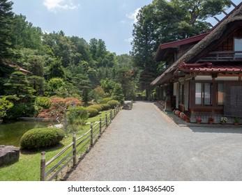 Traditional house at Oshino Hakkai village, Japan. Oshino Hakkai is a small village in the Fuji Five Lake region, located between Lake Kawaguchiko and Lake Yamanakako.
