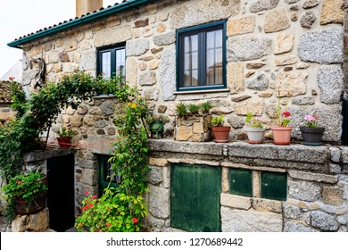 Traditional house using local granite stone on a street of the historic village of Linhares da Beira, Beira Alta, Portugal