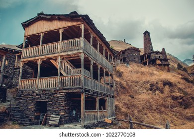 Traditional house in village Dartlo with stone defensive towers in Tusheti. Adventure holiday. Travel to Georgia. Green ecology tourism. Eco trekking tour. Balcony decorated with fretwork