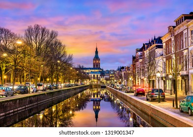 Traditional houses beside a canal in the Hague at sunset. The Netherlands