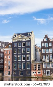 Traditional houses at the Damrak in Amsterdam, The Netherlands