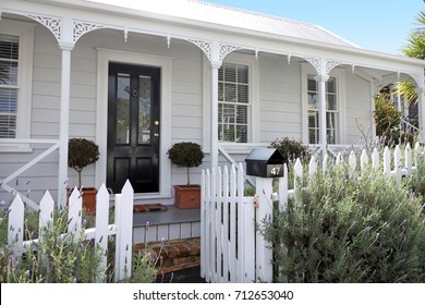 Traditional houses front in suburb in Auckland New Zealand. Traditional villa in Ponsonby Auckland, New Zealand.Buy, sale, real estate, insurance, mortgage, bank loans and housing market concept.