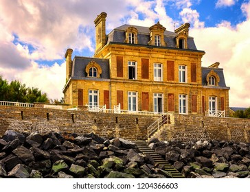 Traditional houses on the beach of Arromanches, Normandy, France