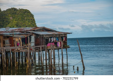 Traditional houses on stilts over the water. Sandakan city, Borneo, Sabah, Malaysia