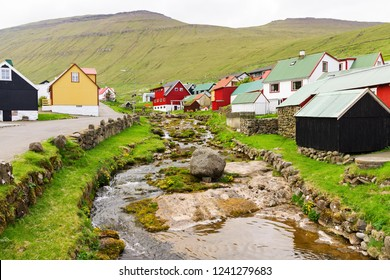 Traditional houses and river in town Gjogv, Faroe islands