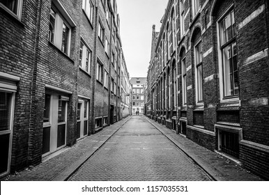 Traditional houses and streets in Amsterdam city. Black-white photo.