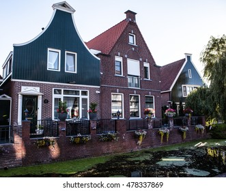 Traditional houses & streets in Holland town Volendam, Netherlands.