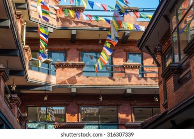 Traditional houses with Tibetan flags in Thamel street, Kathmandu, Nepal