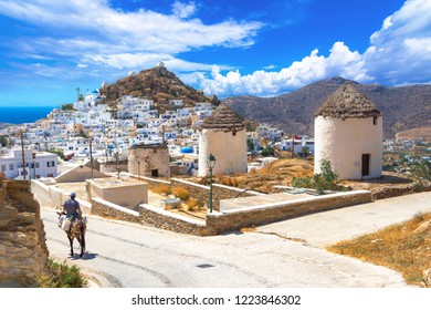 Traditional houses, wind mills, churches  and donkey in Ios island, Cyclades, Greece.