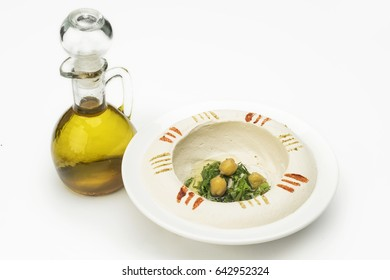 Traditional Hummus with olive oil isolated on white