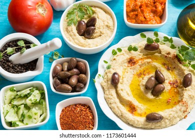 Traditional hummus with vegetables and spices
