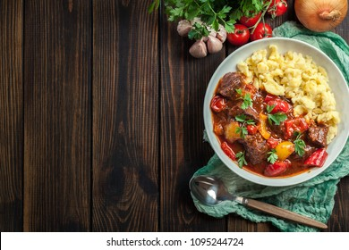 Traditional Hungarian beef goulash serwed with galuska noodles
