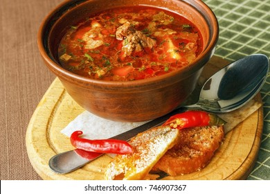 Traditional Hungarian goulash soup bogracs close-up in a bowl on