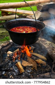traditional Hungarian Goulash soup in cauldron. meal cooked outdoors on an open fire. delicious and healthy food popular in Central Europe